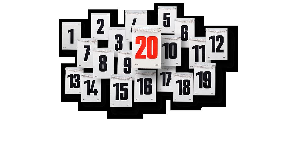 Stapel mit Abreißkalendern mit schwarzen Zahlen und einem mit roter 20